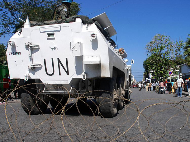 United Nations soldiers patrol the presidential palace perimeter in Port-au-Prince on April 14, 2008, after several days of violence and demonstrations against the cost of living in Haiti.