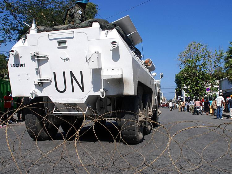 01. United Nations soldiers patrol the presidential palace perimeter in Port-au-Prince on April 14, 2008, after several days of violence and demonstrations against the cost of living in Haiti.