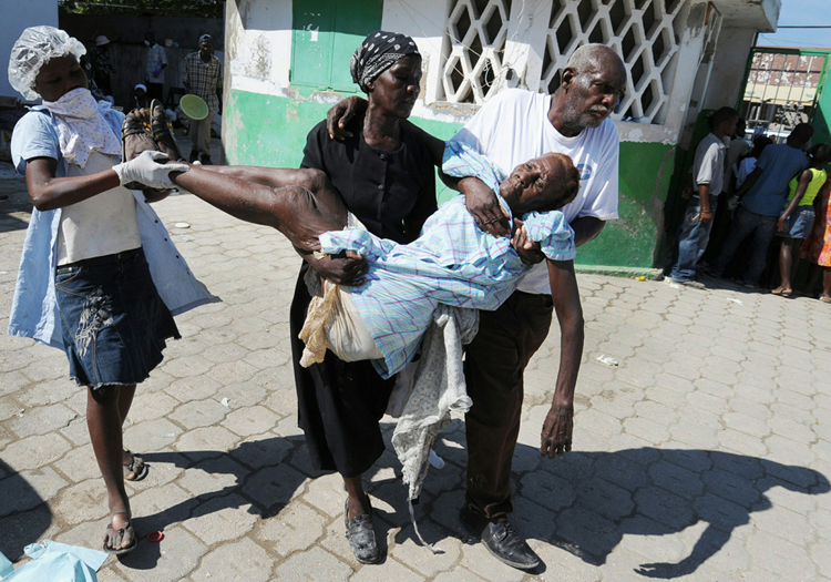 A sick person arrives for medical treatment at a medical facility in St. Marc Hospital, Haiti October 22, 2010.