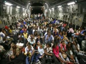 Haitian_children_ailift_cargo_plane_Jan19_2010_mn
