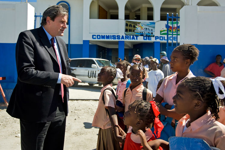 Under-Secretary-General Alain Le Roy speaks with school children during a visit to Cité Soleil, a slum on the outskirts of Port-au-Prince, Haiti. (January 2009).