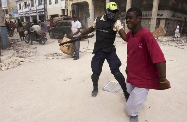 Haitian Police Seizes Lawbreaker in Downtown Port-au-Prince