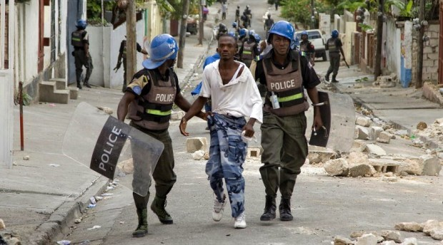 MINUSTAH Police Officers Detain University Student Protesters