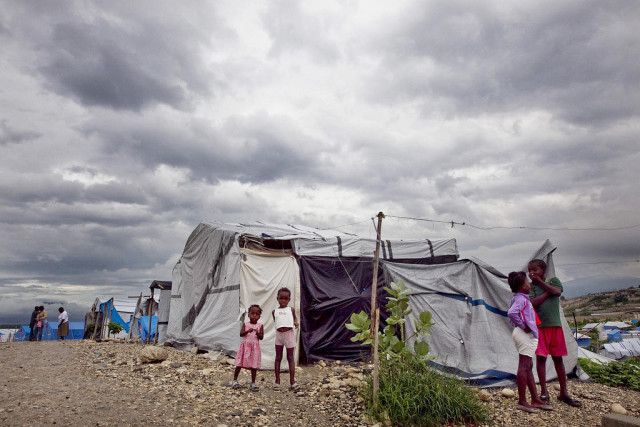 Dark clouds loom over a camp for people displaced by the January 2010 earthquake, in Port-au-Prince, Haiti. Tropical storm Tomas swept over the country, finally dissipating on 5 November, but left behind far less damage than predicted.