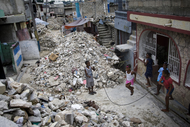 Children jump rope in a rubble-strewn street in the Delmas 32 neighbourhood of Port-au-Prince, Haiti. The UN Stabilization Mission in Haiti (MINUSTAH) is continuing to work with national and international agencies to clear Port-au-Prince of the piles of debris left over from the earthquake that struck the city on 12 January, 2010.