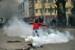 A man kicks a canister with a tear gas during a protest in Port-au-Prince on January 22, 2016.  Demonstrators marched to protest against the presidential elections. Haiti's electoral authority has postponed Sunday's planned presidential run-off amid mounting opposition street protests and voting fraud allegations. The second round of presidential elections was scheduled for January 24 between ruling party candidate Jovenel Moise and Jude Celestin but was suspended by CEP. / AFP / HECTOR RETAMAL        (Photo credit should read HECTOR RETAMAL/AFP/Getty Images)