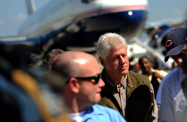 Former President Bill Clinton and his daughter, Chelsea, visit Port au Prince, Haiti, Jan. 18, 2010. As the U.N. envoy to Haiti, Clinton is surveying relief efforts and the damage caused by the Jan. 12, 2010, earthquake. (U.S. Air Force photo by Master Sgt. Jeremy Lock/Released)