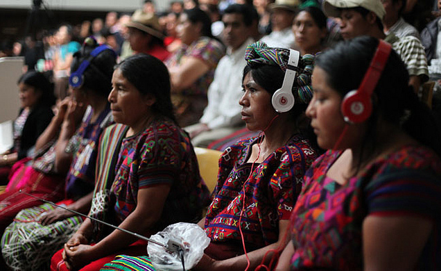 Mayan Ixil Indian women listen to Spanish-Ixil translation of court proceedings during Efrain Rios Montt's genocide trial (Photo credit: Bobertson https://www.flickr.com/photos/9975353@N03/ ).