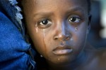 A cholera-infected child cries after receiving medical treatment in L'Estere, Haiti. An outbreak of the disease began in October 2010 and is lasting several months.
