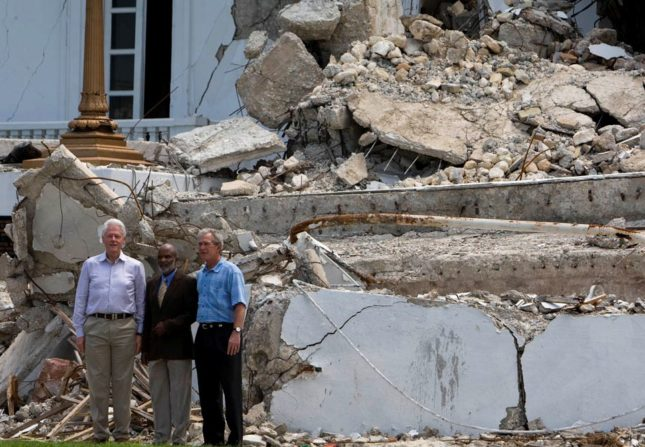 Former Presidents Bill Clinton and George Bush and Haitian President Rene Preval visit the collapsed National Palace after a press conference. Presidents Clinton and Bush are in Haiti for one day visit. Photo Marco Dormino